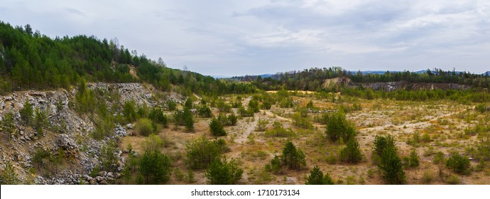 Panoramic view to rock quarry with tree. Nature sanctuary Vyri vrch, Czech republic