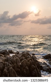 Panoramic view of rocky beach with morning sky, stone beach, background.