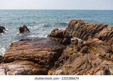 Panoramic view of rocky beach in Thailand, stone beach, background.