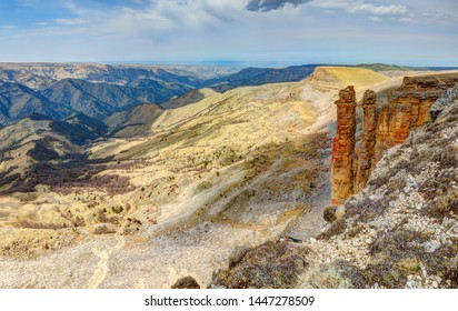 Panoramic view of rocky canyon in daytime.