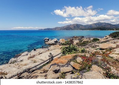 Panoramic view of rocky coast with unusual rocks formations and azure sea water near Villasimius on the south of Sardinia, Italy. People taking pictures. Holidays, beaches in Sardinia.