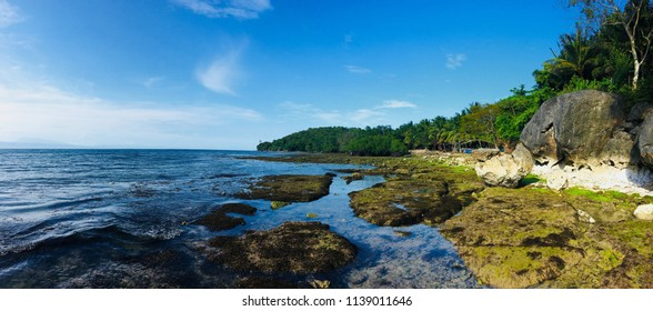 A panoramic view of a rocky seaside in Cebu Philippines during summer season.