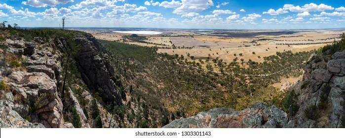 Panoramic view from the rocky summit of Mount Arapiles in Victoria, Australia, toward Mitre Lake Nature Conservation Reserve and Mitre Rock.