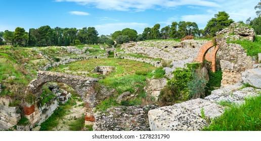Panoramic view to Roman Amphitheatre (Anfiteatro Romano) of Syracuse. Sicily, Italy