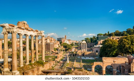 Panoramic view of the Roman Forum in Rome, Italy. Roman Forum is one of the main tourist attractions in Europe. Scenic ruins of the Roman Forum in summer. Panorama of Roman Forum in the sunlight.