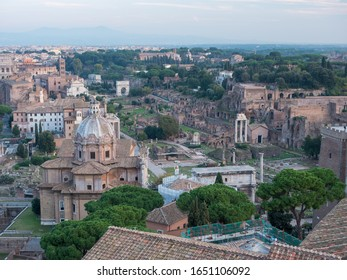 Panoramic view of the Rome city with the Roman Forum (Foro Romano) and the Colosseum (Colosseo) in Lazio, Italy.