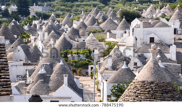 Panoramic view of the roofs of famous Alberobello's trulli, Apulia, Italy
