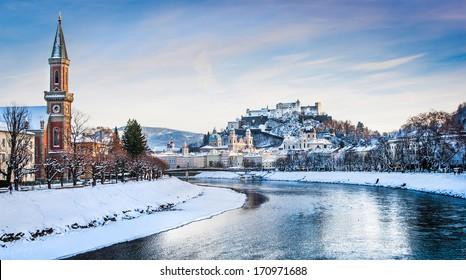 Panoramic view of Salzburg skyline with Festung Hohensalzburg and river Salzach in winter, Salzburger Land, Austria