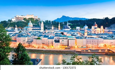 Panoramic view of Salzburg skyline with river Salzach at dusk as seen from Kapuzinerberg in Salzburg, Salzburger Land, Austria