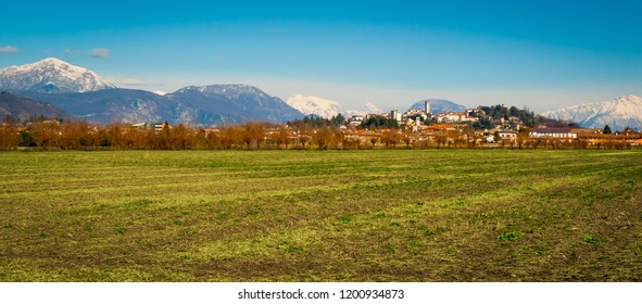 Panoramic view of San Daniele del Friuli from the surrounding fields on a sunny winter day, Friuli Venezia-Giulia, Italy