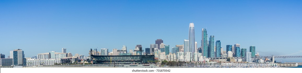 Panoramic view of San Francisco skyline as seen from the waterfront on a sunny and clear day