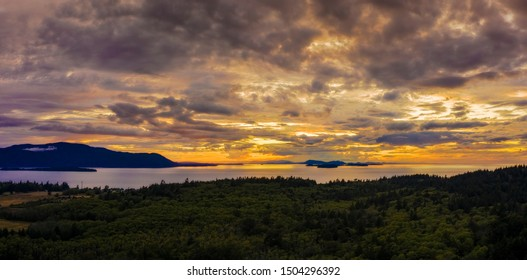 Panoramic View of the San Juan Islands of Puget Sound. Aerial shot of Orcas Island and Matia Island as seen from Lummi Island during a glorious and dramatic sunset in the Salish Sea.