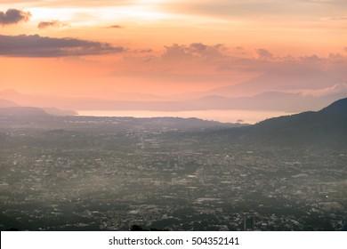 Panoramic view of the of San Salvador city at dawn overlooking the Ilopango lake..