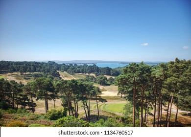 A panoramic view of Sandbanks, the Purbeck Hills, Brownsea Island and a golf course from Poole on the Dorset Coast in England, UK in the summer.