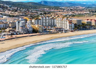 Panoramic view of sandy beach, coastline and cityscape of Peniscola. Popular, famous travel destinations for vacationers, travelers and tourist. Turquoise Mediterranean Sea. Costa del Azahar. Spain