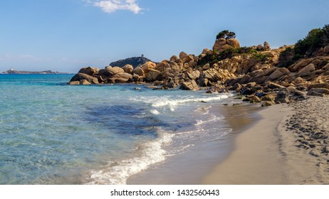 Panoramic view of sandy beach, rocks and sea with azure water, in Villasimius, Sardinia (Sardegna) island, Italy. Holidays, the best beaches in Sardinia.
