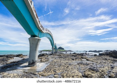 Panoramic view of Sansiantai bridge with beautiful sea level and reef rocks under fantasy blue cloudy and sunshine sky in Sansiantai Taitung. the famous attractions in Taiwan.