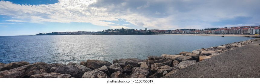 Panoramic view of Sanxenxo touristic city from the harbor breakwater