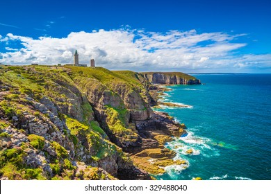 Panoramic view of scenic coastal landscape with traditional lighthouse at famous Cap Frehel peninsula on the Cote d'Emeraude, commune of Plevenon, Cotes-d'Armor, Bretagne, northern France