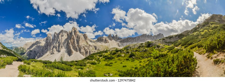Panoramic view of scenic hiking trail in  Italian Dolomites on sunny summer day.