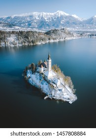 Panoramic view of scenic Lake Bled with famous Bled Island and castle (Blejski grad) in the background on a beautiful sunny day in winter, Slovenia