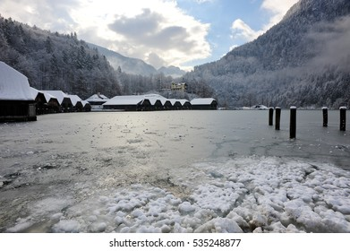 Panoramic view of scenic mountain scenery with Lake Konigssee turn to frozen with traditional house