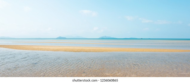 Panoramic view, scenic tropical sea in summer. Beautiful ripple marks on golden sand beach, clouds and light blue sky, islands backgrounds. Sunshine day. Koh Mak Island, Trat, Thailand. Copy space.