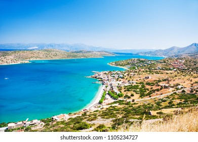 Panoramic view of sea coast and Spinalonga island in Elounda, Crete, Greece.