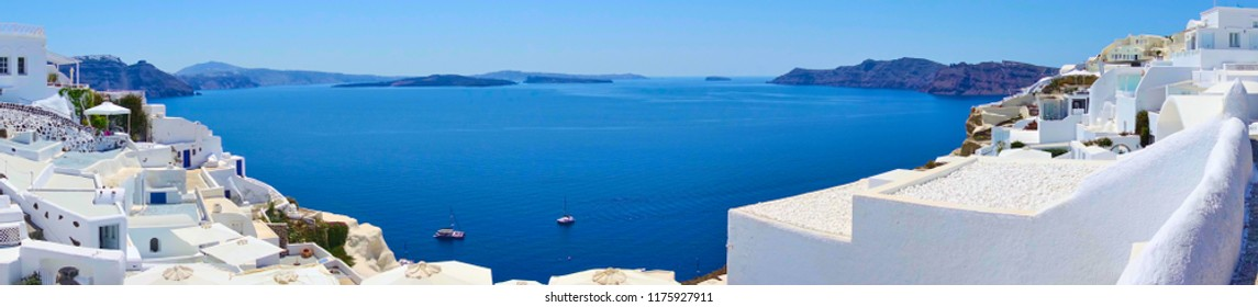Panoramic view of sea and islands from Oia in Santorini, Greece