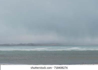 panoramic view of seascape with mountain hills in foggy morning