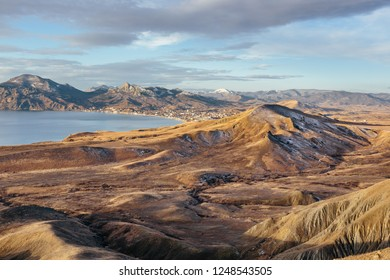Panoramic view of seaside resort city, mountains and hills in sunny winter morning. Koktebel, Crimea