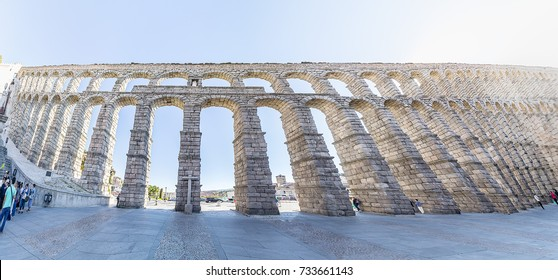 Panoramic view of segovia roman aqueduct with backlight, in autonomous region of Castile and León.  Declared World Heritage Sites by UNESCO
