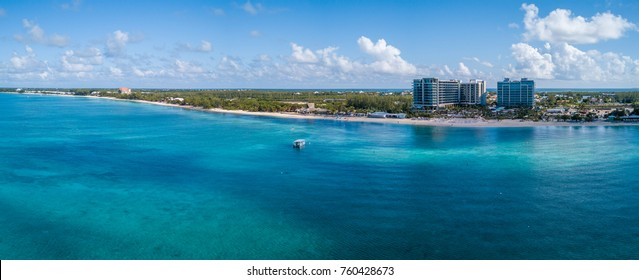 panoramic view of seven mile beach in the tropical paradise of the cayman islands in the caribbean sea taken from a drone