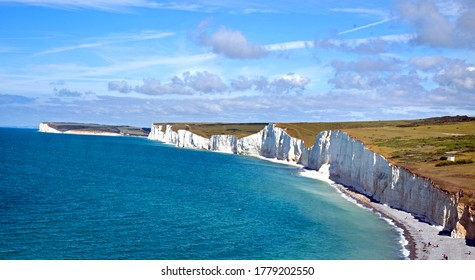 Panoramic view of Seven Sisters chalk cliffs against a nice bright blue hazy sky