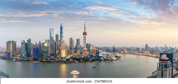panoramic view of shanghai skyline at dusk, beautiful huangpu river with pudong financial center and the bund, China.