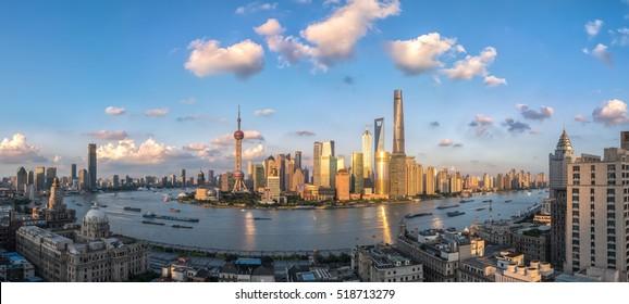 panoramic view of shanghai skyline and huangpu river in nightfall , China