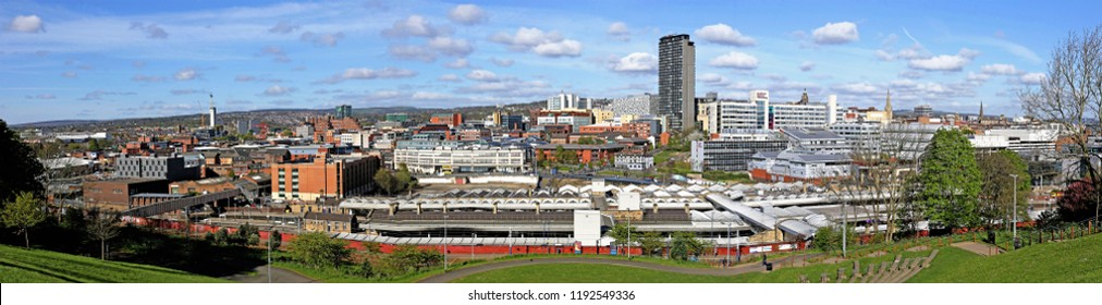 Panoramic view of Sheffield from ground above the station overlooking Sheffield Hallam University and the station, Arundell Gate, on a clear summer's day, few floaty clouds, stitched photo