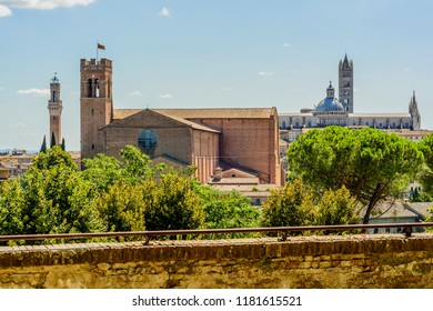 A panoramic view of Siena, Toscany. In this view there are the Cathedral (Duomo) and Tower of Mangia (torre del Mangia), two symbols of the city, and the church of Saint Dominic (San Domenico)