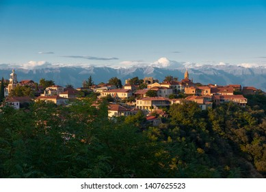 Panoramic view of Signagni in winery region of Georgia, Kakheti, during sunset in summer with Caucasus mountains in the background