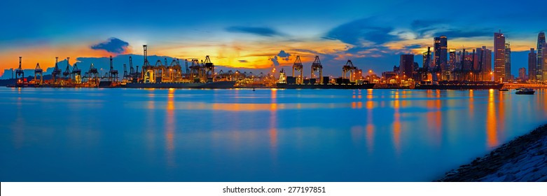 Panoramic view of Singapore container port at sunset