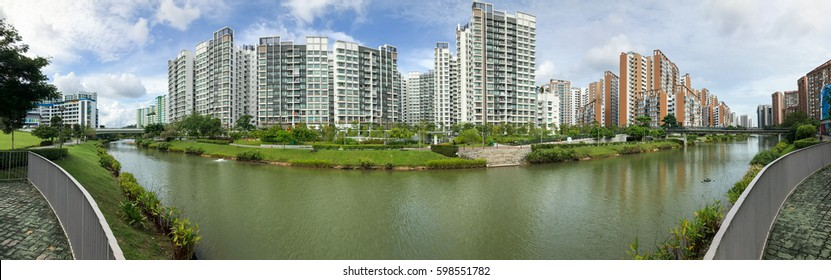 Panoramic view of Singapore Public Housing Apartments in Punggol District, Singapore. Housing Development Board(HDB) with beautiful water way and blue sky