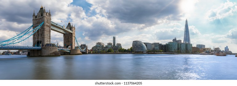 Panoramic view of the skyline of London: from Tower Bridge to London Bridge on a sunny summer day