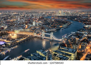Panoramic view to the skyline of London: from the Tower Bridge along the Thames river to Canary Wharf district during sunset time