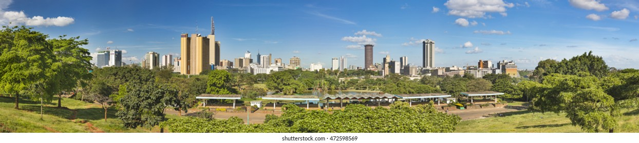 Panoramic view of the skyline of Nairobi, Kenya with Uhuru Park in the foreground.