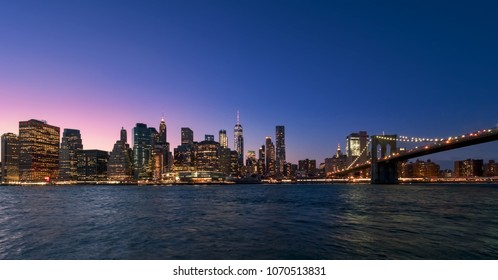 Panoramic view of the skyscrapers of Manhattan, from Brooklyn, during the blue hour of dusk