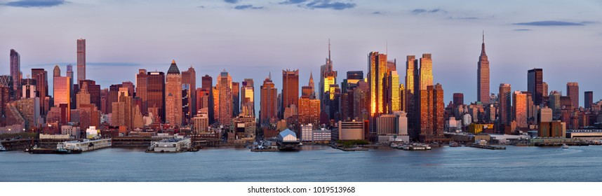 Panoramic view, skyscrapers of Midtown Manhattan at sunset with the Hudson River. New York City