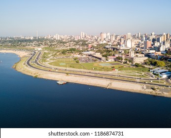 Panoramic view of skyscrapers skyline of Latin American capital of Asuncion city, Paraguay. Embankment of Paraguay river. Birds eye aerial drone photo. Ciudad de Asunción Paraguay. South America.