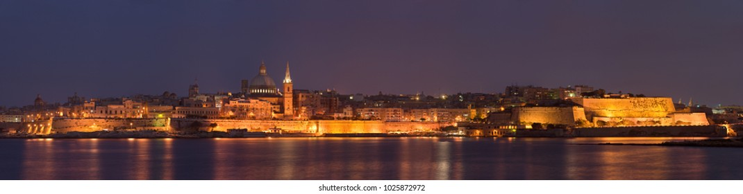 Panoramic view from Sliema to Valletta with beautiful illumination shortly after sunset.