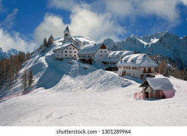 Panoramic view of small ancient village on the top of Monte Lussari in Tarvisio.Julian Alps, Italy.