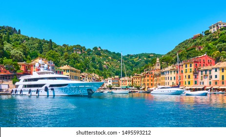 Panoramic view of small port with yachts and boats in Portofino town, Liguria, Italy